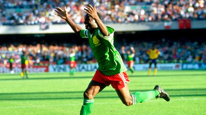 Roger Milla celebrates the goal against Colombia, his second of the match, after ridiculing René Higuita