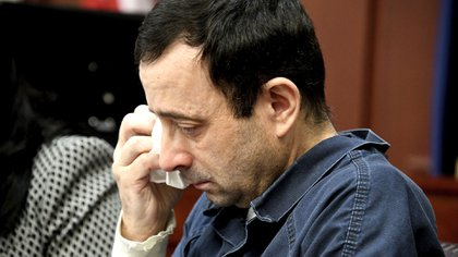 Nassar was sentenced to spend the rest of his days in jail (Dale G. Young / Detroit News via AP)